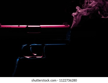 Smoking hand gun in red and blue light