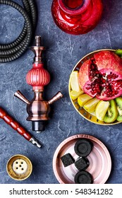 smoking hookah and dish with kiwi,pomegranate and lime