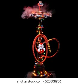 Smoking hookah with New Years decorations on dark background