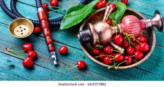 Smoking hookah.Fruit shisha.Eastern smoking nargile with cherry flavor.Hookah tobacco with cherry flavor
