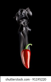 Smoking Hot Red Jalapeno Pepper isolated on a pure black background.