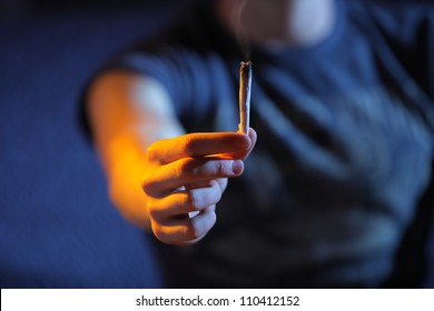 Smoking joint. Hand close up. Copy space