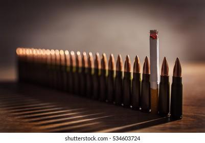 Smoking kills. Cigarette among the bullets. Conceptual image.
