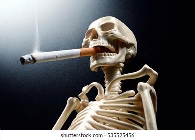 smoking kills. Human skeleton smoking a cigarette.