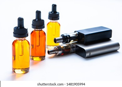 Smoking liquids and vapes. The concept of vaping. Gadgets for vapers. Smoking electronic cigarettes. Vaping shop. Vaping accessories.