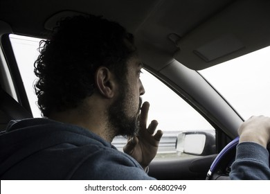 Smoking man driving by car, addition and vehicle