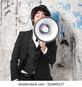 smoking man shouting with megaphone