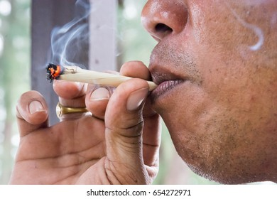 Smoking man with tradition cigarette and