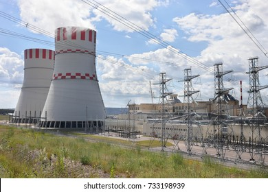 Smoking pipes, poles with wires of atomic thermal power plant at summer