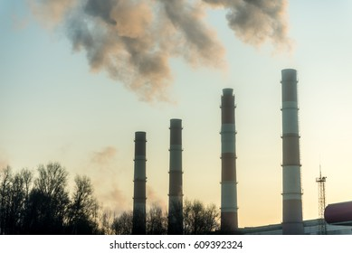 Smoking pipes of thermal power plant on sunset