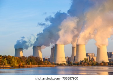 Smoking pipes of thermal power plant on sunset.