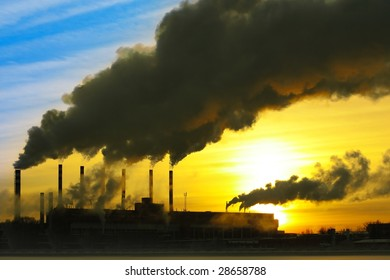 Smoking plant over sunset