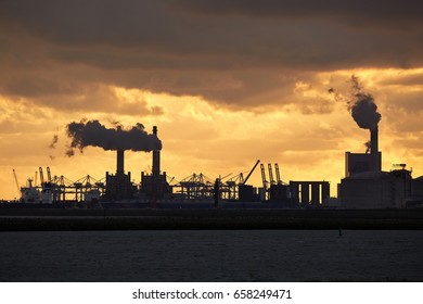 Smoking power plants in an industrial dock area