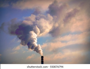 Smoking stack from lignite power plant. Digital artwork on air pollution and climate change theme. Industrial background.
