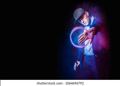 smoking vape. vaping man holding a mod. Vape Rings. A man launches a ring of smoke. Tricks with smoke. A man smokes an electronic cigarette. A large ring of smoke.