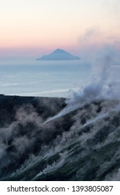 Smoking Vulcano in the sunset, the background is the Filicudi vulcan