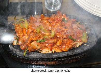 Smoky beef sizzler on sizzling plate
