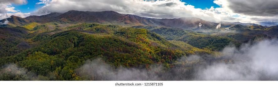 smoky mountains in  the fall with mist