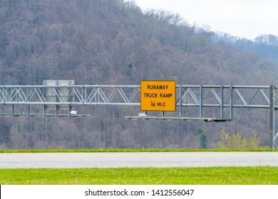 Smoky Mountains near Asheville, North Carolina at Tennessee border during spring day on South 25 highway road with sign for Runaway truck ramp