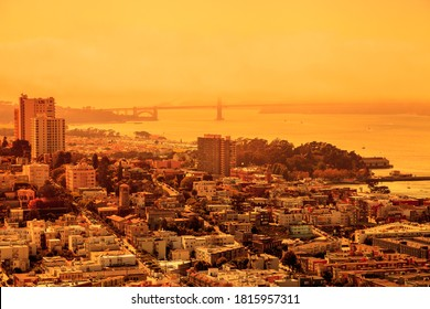 Smoky orange sky of San Francisco skyline. California fires in United States. Composition about wildfires and climate change concept.
