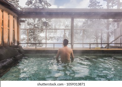 Smoky Outdoor Onsen (Hot Spring) With Snow in Winter at a Ryokan of Zao Hot Spring, Yamagata , Japan