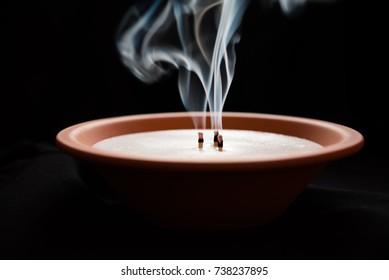 Smoky porcelain candle.