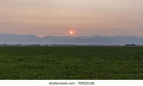 Smoky sunrise over the Bridger Mountains in Bozeman, MT