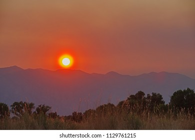 smoky sunset over the Sierra Nevada caused by smoke from the Lions Fire in California