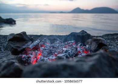 Smoldering ashes from a campfire next to Lake Koya in Hokkaido, Japan