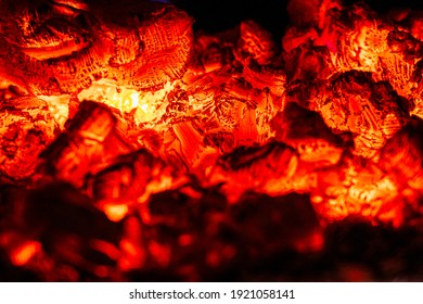 Smoldering coal, glowing embers in the fireplace