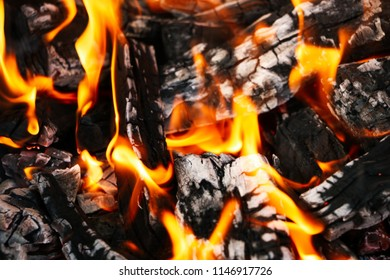 Smoldering coals from the fire. A fading bonfire. Close-up. Texture.