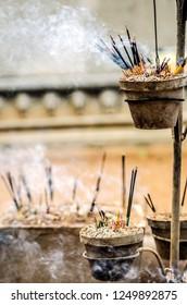 Smoldering sticks in the temple Kalutara. Sri Lanka.