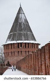 SMOLENSK, RUSSIA - DECEMBER 25, 2011: Unidentified people walk on the wall of  Smolensk Kremlin after snowfall.