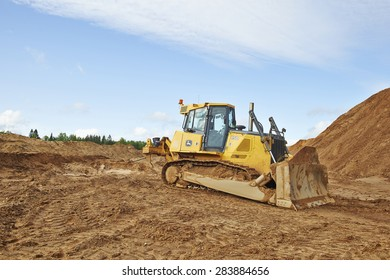 Smolenskiy region, RUSSIA - May 23: Deer tractor parked on sand quarry on may 23, 2015