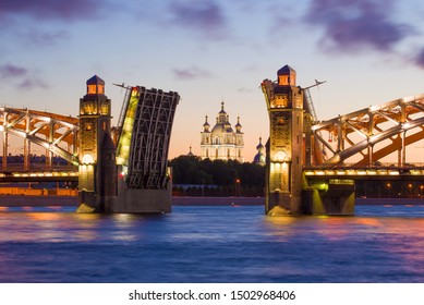 Smolny Cathedral in the cross section of the divorced Peter the Great Bridge (Bolsheokhtinsky Bridge) on a white night. Saint-Petersburg, Russia