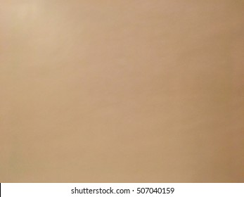 Smooth brown leather surface texture.