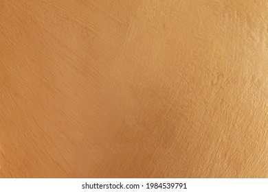 Smooth cement wall inside the building painted in bright gold texture and background seamless - Shutterstock ID 1984539791