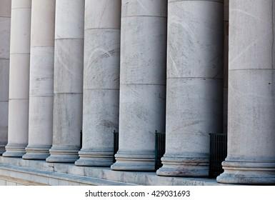 Smooth Doric limestone columns.