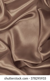 Smooth elegant brown silk or satin can use as wedding background. In Sepia toned. Retro style