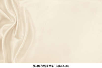 Smooth elegant golden silk or satin luxury cloth texture can use as wedding background. Luxurious Christmas background or New Year background design. In Sepia toned. Retro style