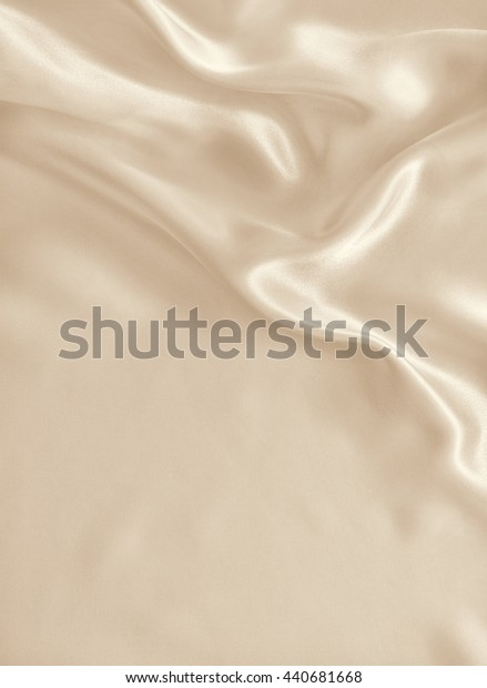 Smooth elegant golden silk or satin can use as wedding background. In Sepia toned. Retro style