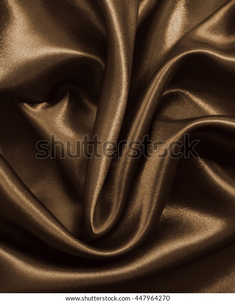 Smooth elegant golden silk or satin can use as background. In Sepia toned. Retro style