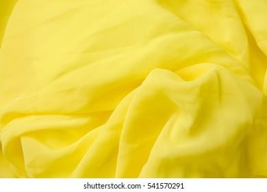 Smooth elegant golden silk, Yellow fabric texture background.