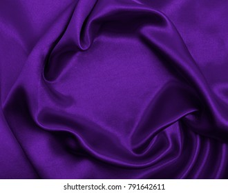 Smooth elegant lilac silk or satin luxury cloth texture can use as abstract background. Luxurious background design