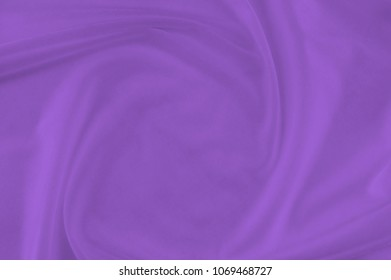 Smooth elegant violet silk or Satin luxury cloth can use as wedding, Christmas or New Year background design, fabric texture and cloth textile surface. top view.