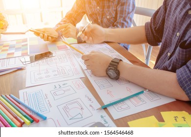 Smooth Focus,A team of web designers are working together to develop a mobile responsive website with UI / UX Front End Designer Previewing. Website development concept UI / UX front end designer