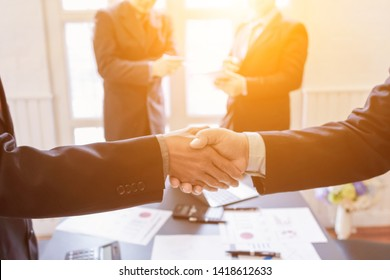 Smooth Focus,Businessmen shaking hands with the company's business consultants to agree on a contract of employment because the investment advisor has been successful and the results are satisfactory.