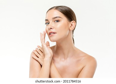 Smooth fresh glowing skin woman touching her face in white isolated studio background for beauty and skincare concepts