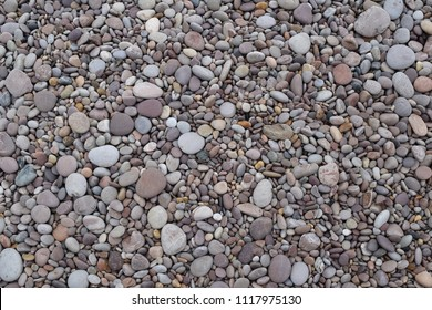 Smooth gray pebbles full frame background