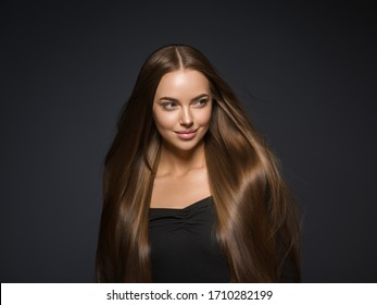 Smooth hair beauty woman longhair brunette female model natural make up beautiful girl over dark background